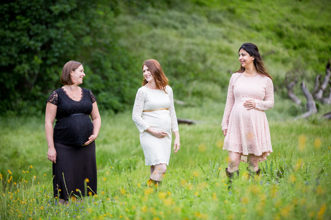 pregnant women dressed in lace dresses